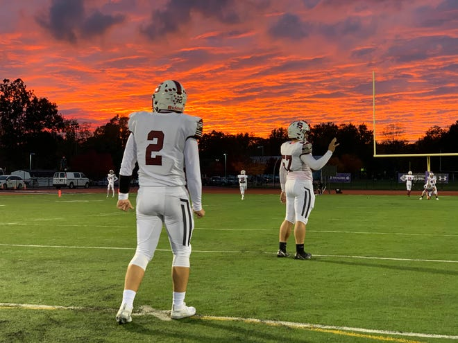 Stroudsburg junior quarterback Ethan Sodl (2) and junior center Xavier Dorst (57) warm up for their game against East Stroudsburg South on Friday, Oct. 16, 2020. The Mounties lost 69-7.