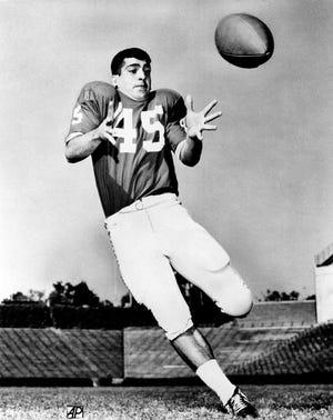 Photo shows Football player, Carlos Alvarez, on Nov. 17, 1969. (AP Photo)