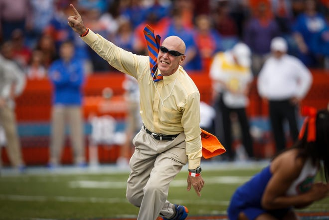 Carlos Alvarez, doing the Mr. Two Bits routine before the home game against Florida State in 2013, was ahead of his times while playing for the Gators from 1969-71.
