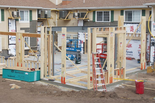 Walls are going up as J.A. Knight &Sons construction workers bring a dining-room expansion plan to life at Parkwood Village, 401 Rochester, Pratt. The expansion is taking place in the former courtyard.