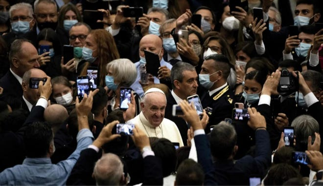 Pope Francis waves as he arrives for a general audience with the Italian police at the Vatican on Sept. 28.