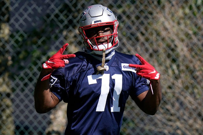 New England Patriots linebacker Josh Uche steps on the field for an NFL football training camp practice, Sunday, Aug. 30, 2020, in Foxborough, Mass.