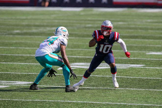 New England Patriots wide receiver Damiere Byrd (10) is defended by Miami Dolphins cornerback Byron Jones (24) during the second half of an NFL football game, Sunday, Sept. 13, 2020, in Foxborough, Mass.