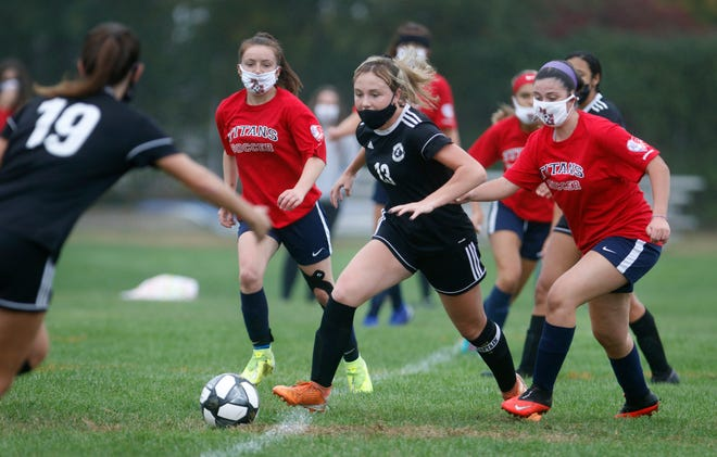 Lily Brown and the Pilgrim girls soccer team (shown in action from last week) got the job done Monday in a 2-1 win over Barrington.