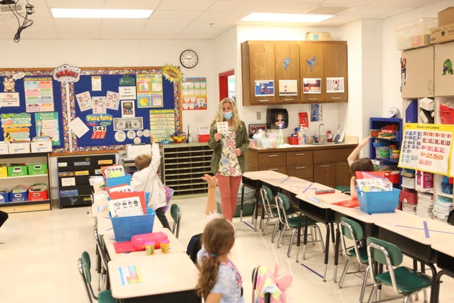 Students and teachers comply with social-distancing precautions at North Smyrna Elementary.