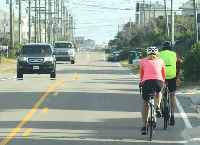 Bikers travel along the roadways in Topsail Beach, N.C. Tuesday Oct. 20, 2020.  Complaints in recent years have prompted South Topsail to develop a bike and pedestrian plan for their roads. They are currently in the process of gathering resident feedback about plans to install an eight-foot wide bike path alongside the road. [KEN BLEVINS/STARNEWS]