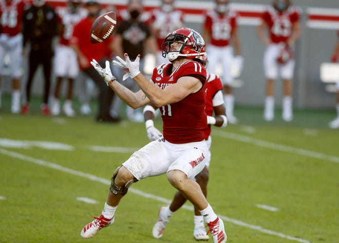 N.C. State linebacker Payton Wilson (11) makes an interception during the second half of N.C. State's 31-20 victory over Duke at Carter-Finley Stadium in Raleigh, N.C., Saturday, Oct. 17, 2020.