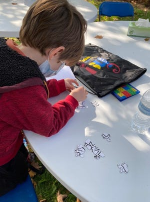 Jasper creating a puzzle at Chabad Hebrew School in Goshen.