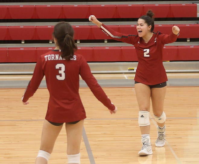 Dover's Grace Rivera and Taylor Luneborg celebrate a point in the Division II Sectional final volleyball match with Maysville Wednesday at Dover.