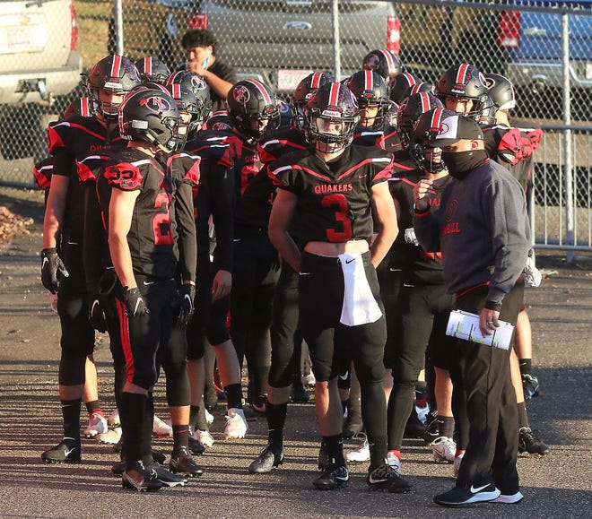 The New Philadelphia Quakers get set to take the field against Youngstown Chaney last Friday night.