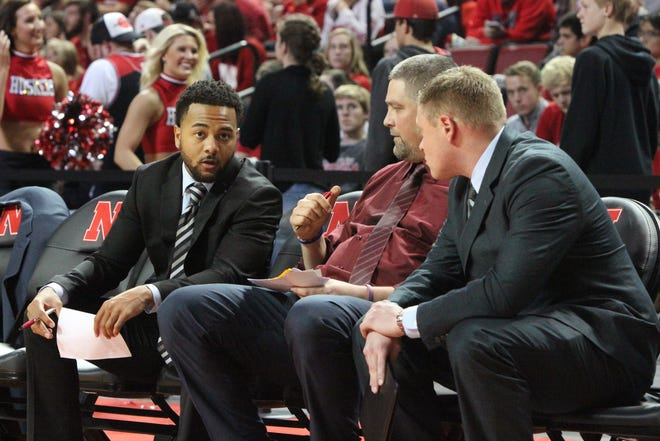 Jalen Little, left, talks to his fellow Chadron State men's basketball coaches. [Courtesy photo/Chadron State College]