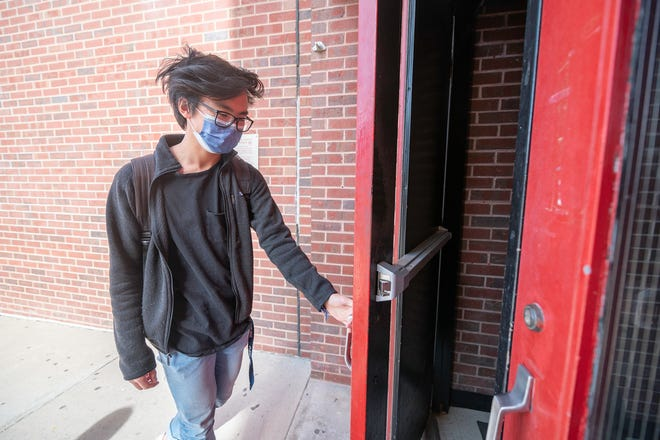 "Centennial High School senior Andrew Li enters the school Wednesday on what he describes as his ""last first day."" [CHIEFTAIN PHOTO/ZACHARY ALLEN]"