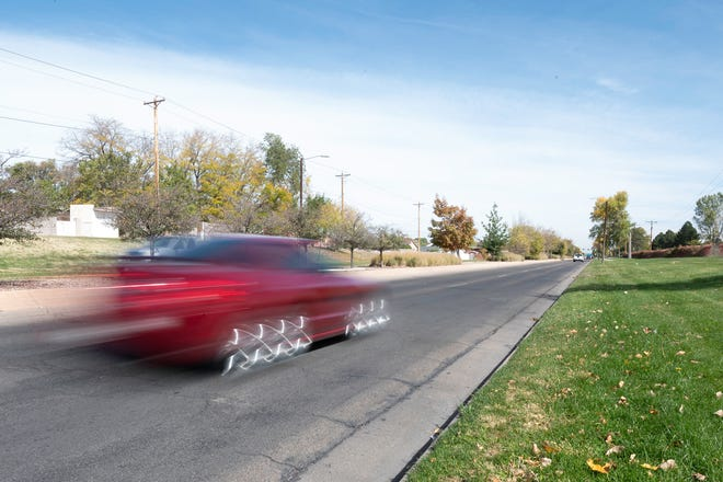A vehicle travels down Northern Avenue, a frequent hot spot for illegal street racing.