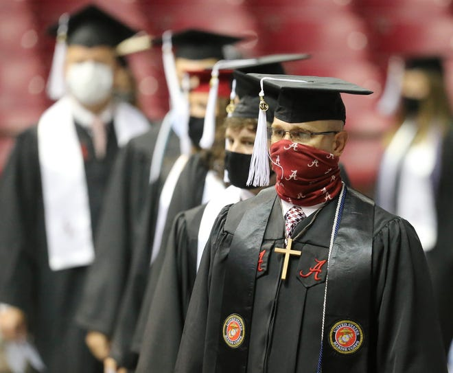 The University of Alabama held joint graduation exercises for Spring and Summer graduates Friday, July 31, 2020, in Coleman Coliseum. Social distancing and mask wearing were enforced and  more than 3,000 graduates participated in nine ceremonies. [Staff Photo/Gary Cosby Jr.]