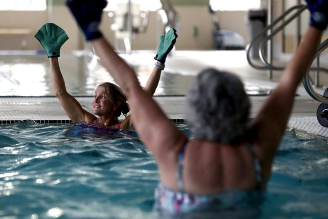 Instructor Donna Eramo leads an Aqua Fit class for seniors in various exercise routines Oct. 21 at the Philip Heit Center for Healthy New Albany, 150 W. Main St. A pilot program developed by the city of New Albany, Healthy New Albany and the Ohio State University Wexner Medical Center Health and Fitness Center will give senior citizens 65 years and older living within New Albany city limits the opportunity to sign up to use the fitness center from 1 to 4 p.m. on Mondays, Wednesdays and Fridays, according to city spokesman Scott McAfee. The program is designed to help keep them safe during the COVID-19 coronavirus pandemic.