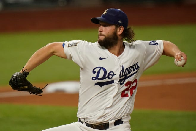 Dodgers starting pitcher Clayton Kershaw throws against the Tampa Bay Rays during the first inning of Game 1 of the World Series on Tuesday, Oct. 20, 2020, in Arlington, Texas.