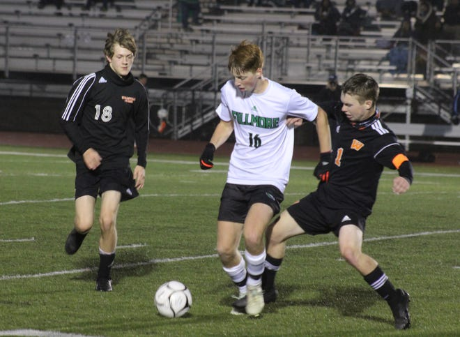 Fillmore's Mason Cool controls the ball under pressure from Wellsville's Alex Ordiway (1) and Aidan Riley (18) Tuesday night.