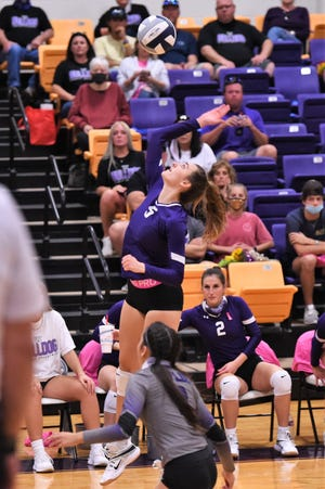 Wylie's Lilly Kate Doby (5) goes up for a kill against Lubbock-Cooper in 2020. Doby, an All-District 4-5A first team pick, leads an experienced Lady Bulldogs into the 2021 season.