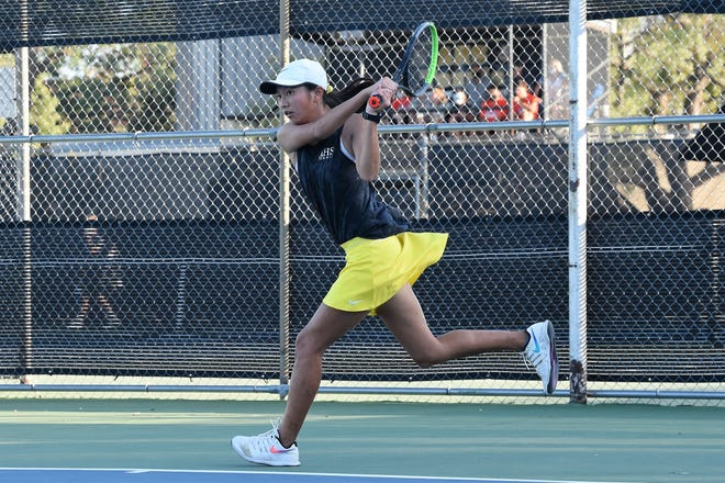 Abilene High's Ruth Hill follows through on a shot during the No. 1 girls singles match against San Angelo Central at the AHS tennis courts on Tuesday, Oct. 20, 2020. The Eagles won 11-8 to claim the District 2-6A title.