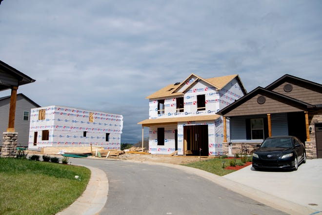 Home sales were one of the few bright spots in the local economy in 2020. In this file photo, construction continues at Sycamore Cottages, a 130-home subdivision in the Fletcher area above Smiley's Flea Market, on Oct. 16, 2020.