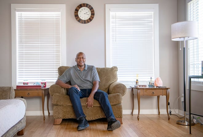 Horace Mazyck sits in his two bedroom home in Arden which he says is the perfect size for a single person on Oct. 19, 2020. He moved into the home in the small Atkinsville neighborhood at the end of August.