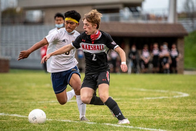 Battle Creek Central junior Thang Khup (8) and Marshall junior Jayson Janofski (2) battle for the ball during the Division 2 District Semifinal at Marshall High School on Tuesday, Oct. 20, 2020 in Marshall, Mich. Marshall defeated Battle Creek Central 6-3.