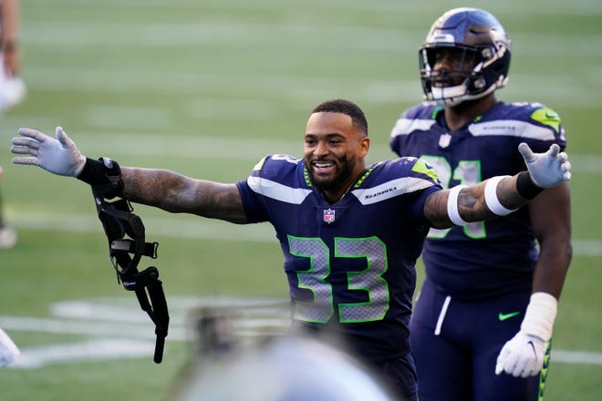Seahawks strong safety Jamal Adams celebrates after Seattle beat Dallas last September. The defensive star did not report to minicamp this week and is reportedly seeking a new contract that could command as much as $20 million per season.