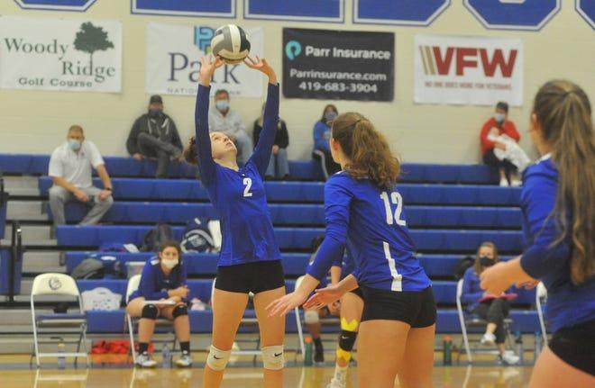 Crestline's Ivy Stewart sets a teammate.