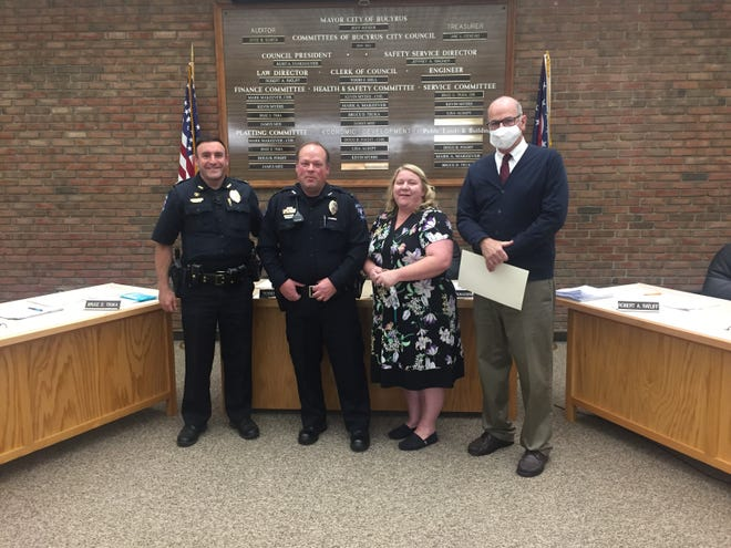 Kevin Wert was promoted to a captain of the Bucyrus Police Department on Tuesday. Pictured from left are: Police Chief Neil Assenheimer; Capt. Wert; Michelle Wert, the captain's wife; and Mayor Jeff Reser.