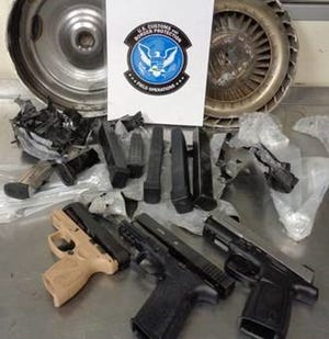 U.S. Customs and Border Protection officers in Cincinnati found handguns and ammunition magazines after opening a shipment labeled as auto parts.