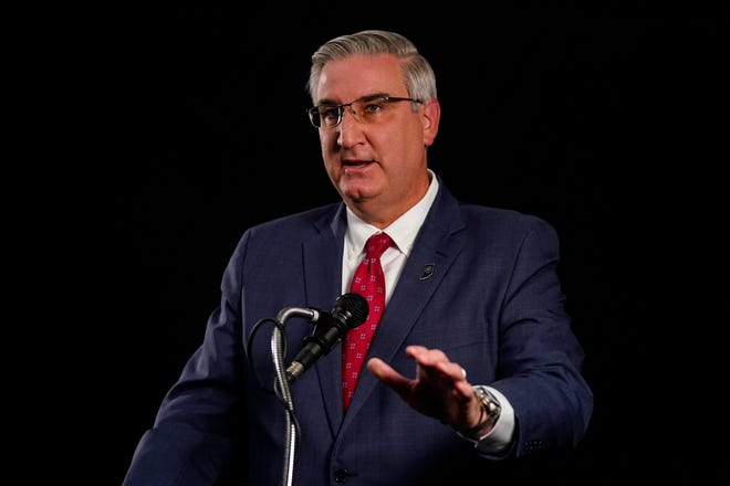 Indiana Republican Gov. Eric Holcomb participates in the Indiana Gubernatorial debate with Democrat Woody Myers and Libertarian Donald Rainwater, Tuesday, Oct. 20, 2020, in Indianapolis. The candidates were in separate studios to allow for social distancing guidelines.