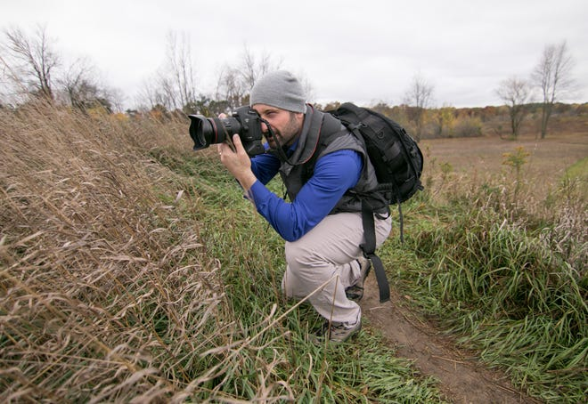 Hartland photographer Daryl Marshke walks the trails of Hartland's Settlers park Wednesday, Oct. 21, 2020 with his camera.
