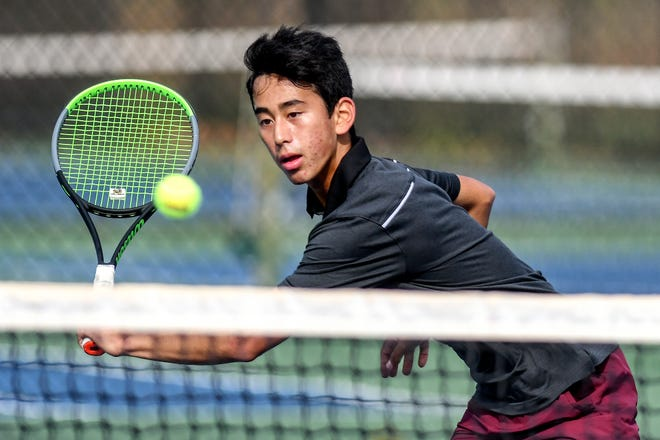 Okemos' Josh Portnoy returns the ball during his Division 1 tennis singles semifinal match against Bloomfield Hills' Noah Roslin on Wednesday, Oct. 21, 2020, at Okemos High School.