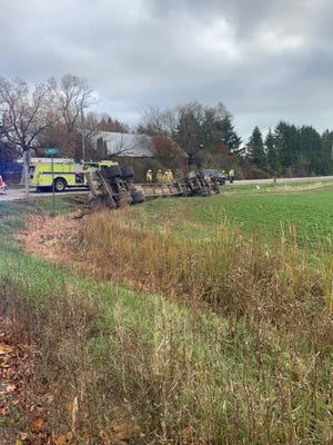 A semi manure hauler rolled over on its side at Elmwood Road and State Highway 42 in Two Rivers Wednesday.