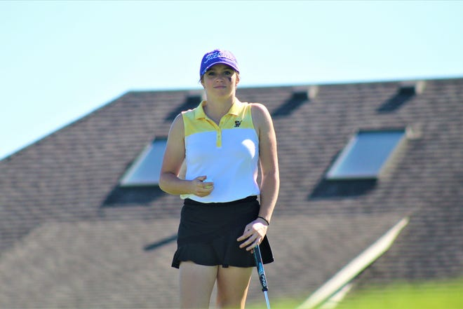 Lexington senior Mandy Ruminski walks off a green at last week's Division I district tournament at Stone Ridge Golf Course in Bowling Green. She will be playing in her fourth state tournament this weekend in Columbus.