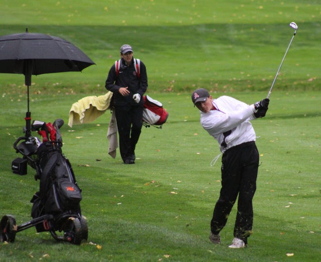Ashland senior Ryan Frazee hits an approach shot on No. 18 during last week's Division I district tournament at Findlay Country Club.