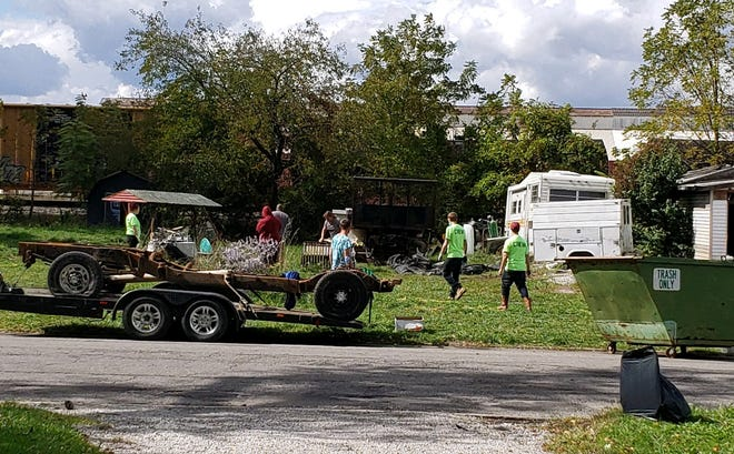 The two community clean-ups, like this one at Parks Boulevard, have been a great outcome for those in the probation program and the community.