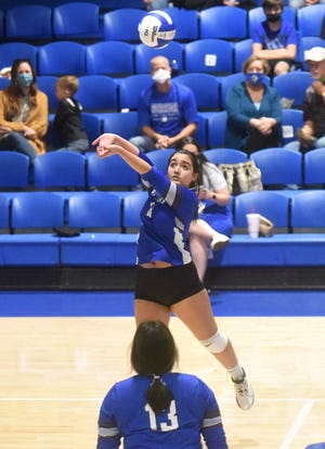 Cotter's Abby Derden passes during a match earlier this season at Cotter. The Lady Warriors defeated Salem on Tuesday to advance to the district championship match.