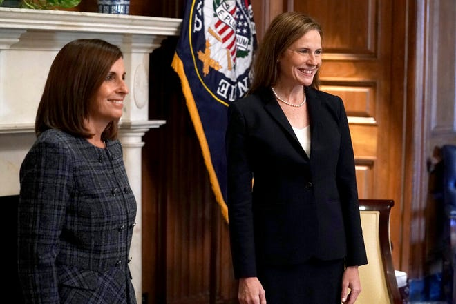 Supreme Court nominee Amy Coney Barrett (right) meets with Sen. Martha McSally, R-Ariz., on Oct. 21, 2020, on Capitol Hill in Washington, D.C.