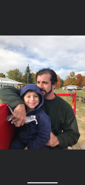 Tim Furman with his four-year-old son Ethan. Tim Furman was killed in a single-vehicle crash in Clyde Township on Monday, Oct. 19, 2020.