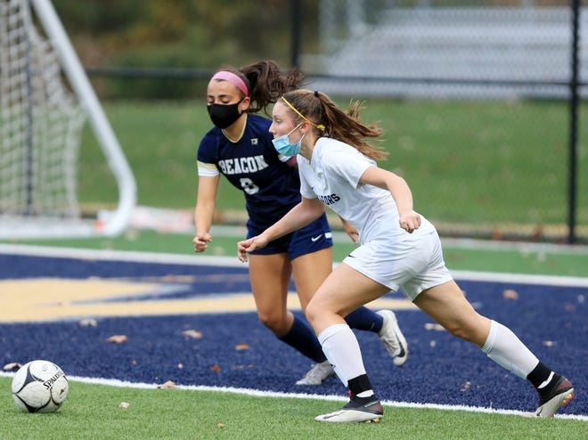 Lourdes' Abigail Umhoefer is covered by Beacon's Gabby Del Castillo during Wednesday's girls soccer game at Beacon High School on October 21, 2020.