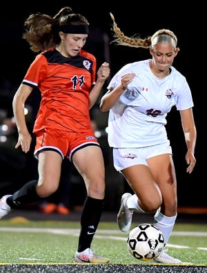 Northeastern's Lorelei Hartzfeld, left, Central York's India Deck battle for possession in girls' soccer at Northeastern Tuesday, Oct. 20, 2020. Central went on to win 1-0. Bill Kalina photo