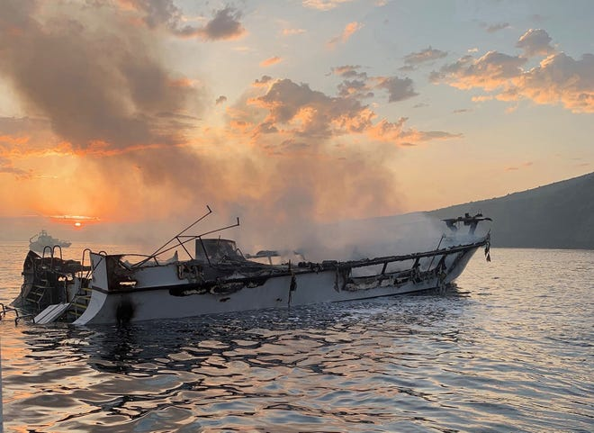 The Conception smolders from a fire that engulfed the dive boat off Santa Cruz Island on Sept. 2, 2019.