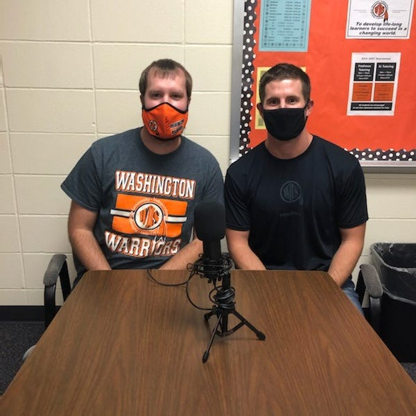 Washington High teachers Grant Schouten and Jeff Tobin (left to right), sit in front of their mic before airing a new episode of their podcast, Warrior Way. Named after the high school's mantra, the two thought the podcast would be a good way to show what's happening on campus this year during a pandemic, when visitors are limited.