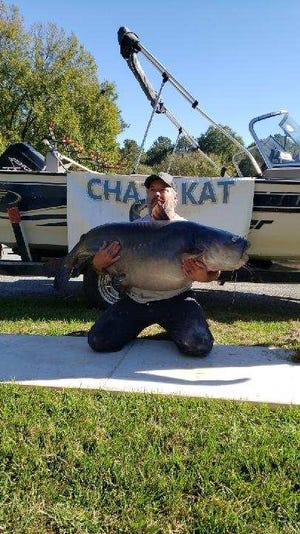 Tim Trone of Havana with his Georgia state record blue catfish that weighed 110 pounds, 6 ounces.