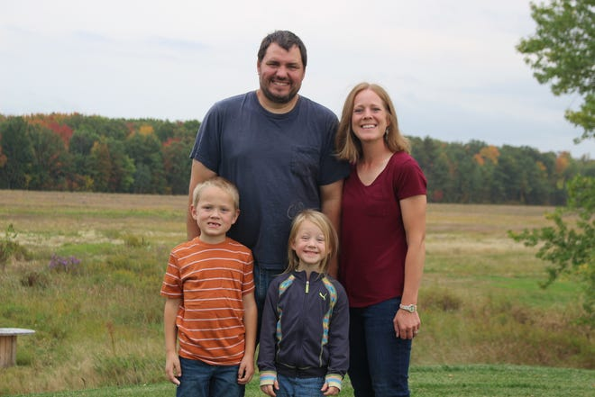The Eron family: farmers John and Melissa Eron, with their children Jack and Nora.