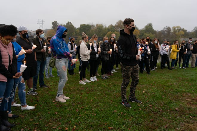 A little rain did not deter more than 100 of Valerie Hickman's friends, mostly students and young adults, who formed a circle with candles in hand to share stories and sorrow about the young woman who died unexpectedly Sunday morning at the age of 20.