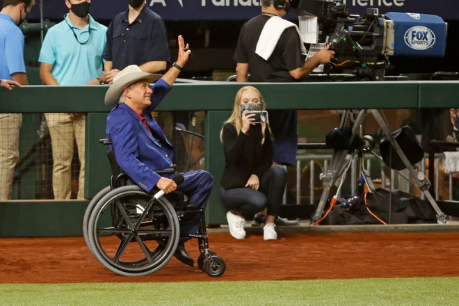 Greg Abbott on the field before Game 1 of the 2020 World Series.