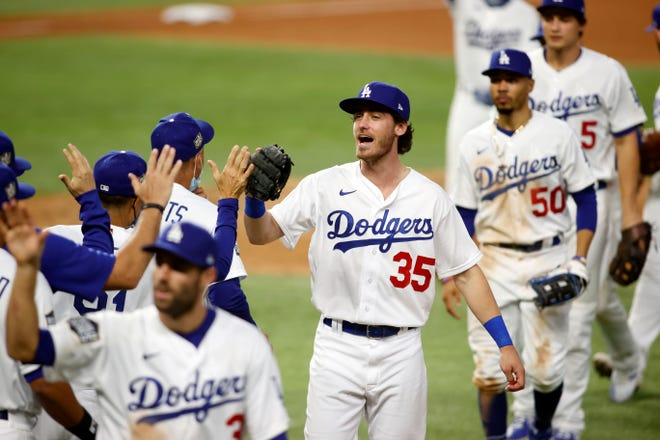 The first game: the Dodgers celebrate after winning.