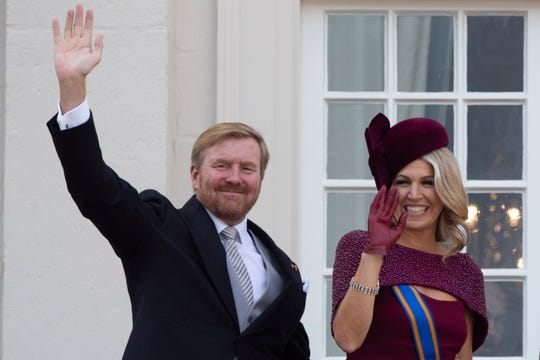 In this Sept. 17, 2019 file photo, Dutch King Willem-Alexander and Queen Maxima wave from the balcony of royal palace Noordeinde in The Hague, Netherlands.